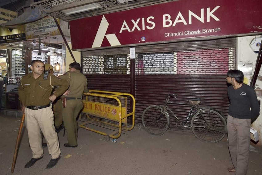 RBI Imposes Rs 3 Cr Penalty on Axis Bank, 2 Cr On IOB