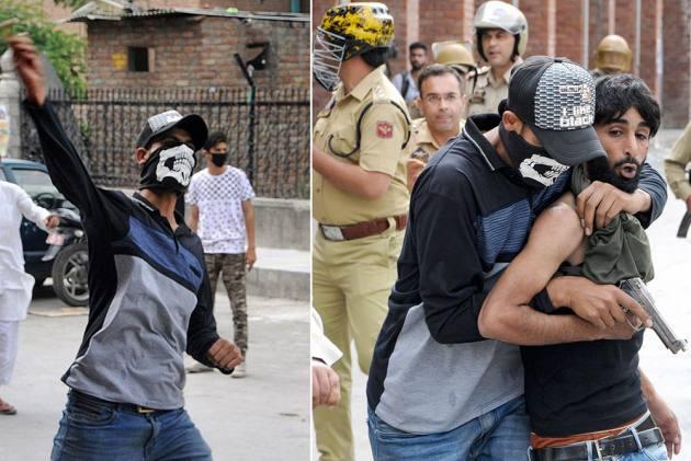 J&K Policemen Disguise As Stone Pelters To Arrest Culprits