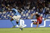 Liverpool's Mohamed Salah, right, tries to score as Napoli's Kalidou Koulibaly defends during the Champions League Group E soccer match between Napoli and Liverpool, at the San Paolo stadium in Naples