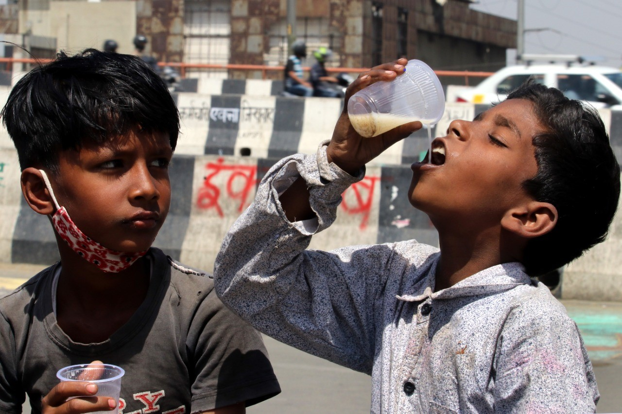 Children drinking lassi, a refreshing drink at Ghazipur Border in New Delhi