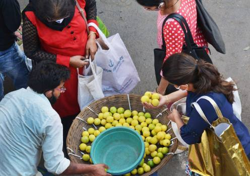 As today is National Vitamin C day, people are purchasing limes from the market to protect themselves from the virus at Borivali market, Mumbai.