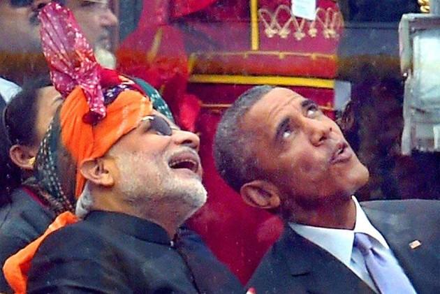 Modi Promises Predictable Tax Regime, Obama Raises IPR Issue
